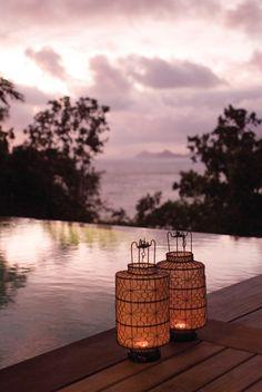 Take a dip at sundown at Four Seasons Resort Seychelles.