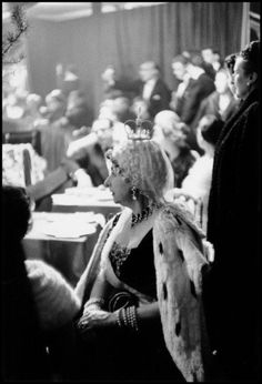 France. Paris. 1955. Violet Trefusis as Anne of Russia relaxes in the audience. Her costume was designed and donated by M. Gregorio Pomar who also performed with Count Guy de la Biliais as The Double Eagle. , 1955  by Inge Morath  Photograph