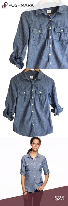 J.C r e w • C h a m b r a y • S h i r t • Sz XS J.Crew two-pocket chambray shirt Sz XS              Cotton. Long roll-up sleeves with button-tabs. Machine wash. J. Crew Tops Button Down Shirts