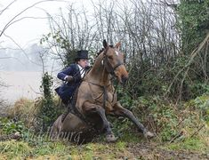 Devon aside on Gutless negotiating a big ditch! Photo by Karen Monroe of Middleburg Photography