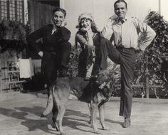 Charlie Chaplin, Mary Pickford, and Douglas Fairbanks, on the set of Through the Back Door, 1921.