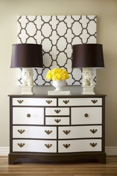 love the two toned dresser and the matching canvas/lamps!