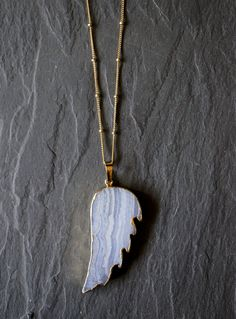 Blue Lace Agate pendant in a wing shape. Blue Lace Agate is the stone of encouragement and support. Its circular flowing energy calms, uplifts and elevates.