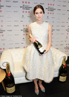 Keira Knightley..  Simone Rocha spring 2015 texture blend flower appliqué dress with fur trimmings..