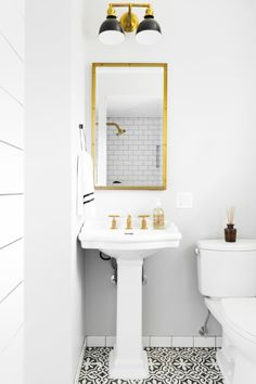 Transforming a powder room into a proper guest bedroom bathroom is no easy feet, but Homepolish's Lindsay Pincus pulled it off with flair.