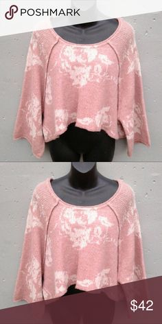 Free People Cropped Sweater Dusty pink with white floral accents.  Size tag has been removed.  Oversized fit. Never worn.                       Beautiful sweater I just ordered the wrong size Free People Sweaters