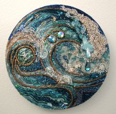 WOW I can not believe this is made with beads. Ocean bead mosaic by Diana Maus