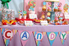 candyland birthday party of rainbow colored sweets triangle table banner
