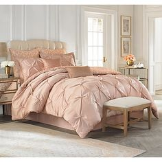 Vince Camuto delivers a fashion forward blush and neutral pairing in the Rose Gold bedding collection. The silky comforter face features hand tied knots for a decidedly feminine ruched effect.