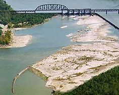 One of the largest naturally exposed fossil beds in the world opened about 10 years ago at Indiana's Falls of the Ohio State Park along the Ohio River in Clarksville, Indiana (about 100 miles southwest of Cincinnati, just across the river north of Louisville, Kentucky).Falls of the Ohio State Park in Indiana | Midwest Living