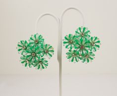 1950's Fun Plastic Flower Clip On Earrings by KatsCache on Etsy https://www.etsy.com/listing/498063870/1950s-fun-plastic-flower-clip-on