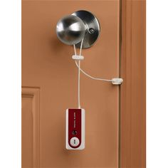 """Belle Hop -Travel Door Alarm by Belle Hop """"Simply hang the alarm on the door knob and place the metal """"pincher"""" in-between the door and the door frame. If an intruder enters, the metal sensor immediately separates and sets off the loud alarm."""""""