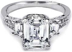 Tacori Trapezoid & Pave Diamond Engagement Ring  : Step it up with a unique and bold emerald-cut solitaire with two trapezoid-shaped side stones. The high-polished knife edge band is set with dazzling rows of pave.