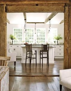 In love the barn wood beams and the white kitchen. I am also installing large windows in a white kitchen with small island. Timber Kitchen, Kitchen White, Kitchen Windows, Rustic Kitchen, Open Kitchen, Floors Kitchen, Kitchen Island, Craftsman Kitchen, Crisp Kitchen