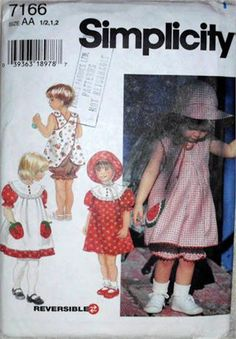 Simplicity 7166Pattern Girls,   Size 6 months to 2 yrs,   Toddler Dress, Reversible Pinafore,    Top and Panties and Hat,   Factory Folded Uncut. Envelope shelf wear.