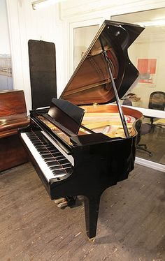 A 2017, Kawai GM10 baby grand piano for sale with a black case and square, tapered legs at Besbrode Pianos £7500.