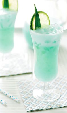 BLUE HAWAIIAN 2 ounces pineapple juice, 1 1⁄2 ounces vodka, 3⁄4 ounce blue Curaçao liqueur, 1⁄2 ounce fresh lime juice, 1⁄2 ounce simple syrup, Splash of half-and-half, Pineapple leaf and lime wheel. Combine in shaker with ice, shake, Strain into tall glass filled with crushed ice. (Or combine everything in a blender cup. Add 3⁄4 cup of crushed ice and flash blend for 5 seconds. Pour into cocktail glass.) Garnish with the pineapple leaf and lime wheel.