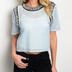 """LIGHT BLUE PERFORATED WHITE AND BLACK TRIMMED TOP Springtime beauty!  This light blue short sleeve perforated top with white and black trim is perfect to pair w jeans or spruce up for work!  The model is wearing a white cami underneath...what color will you wear?  100% polyester. Small measures L19"""" B34"""" W34"""". M and L will measure slightly larger.  L - 2 NO PAYPAL NO TRADES. Due to Poshmark's commission, price is FIRM unless bundled. All sales final. Tops"""