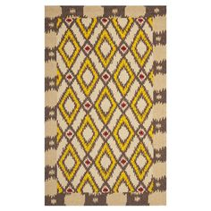 Add a touch of exotic allure to your foyer, den, or three-season porch with this captivating rug, showcasing a tribal-inspired diamonds motif.   ...