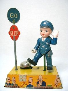 Stop Go Cop wind up toy - composed of tin & celluloid - from the late 30s or early 40s - made in Japan