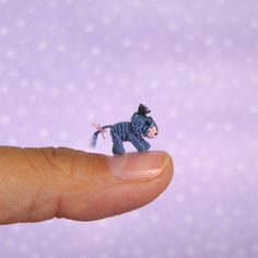 Little Eeyore - 9 mm from head to back. Head and legs are moveable.