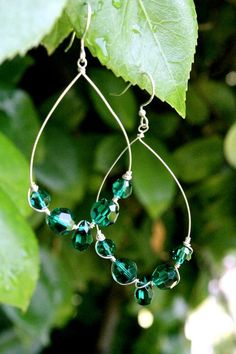 #E0013    A variation of Emerald green Swarovski crystals strung on sterling silver wire.      **CUSTOMIZABLE  **Matching necklace, bracelet and ring available
