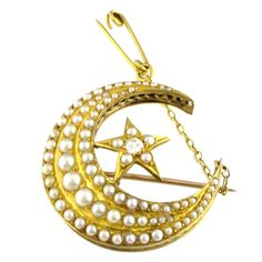 Antique Gold Crescent Moon and Star Brooch. A beautiful Victorian 15ct gold crescent moon and star design, comprising an old cut diamond, approximately 0.14 carats and natural pearls ranging in size from 1.15mm to 3.70mm. Mid to late 1800s