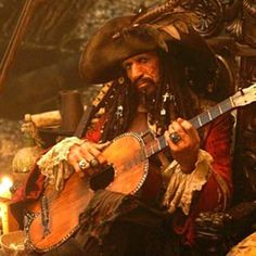 Captain Teague plays the guitar...like how a Rolling Stone would ;)
