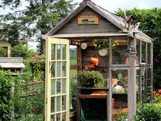 This little wooden potting shed is filled with clever garden art ideas.