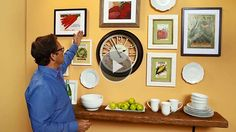 """Picture frames go way beyond family photos. Your wall, designed like a home in """"Better Homes and Gardens!""""/"""
