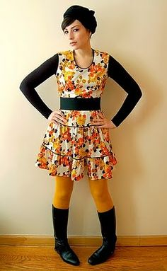 Repurposing a spring dress for wintertime. I'm digging the yellow tights and dress combo.