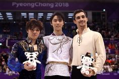 Silver medalist Shoma Uno of Japan, gold medalist Yuzuru Hanyu of Japan and bronze medalist Javier Fernandez of Spain celebrate at the victory ceremony after competing in the Figure Skating Men's Single on day eight of the PyeongChang 2018 Winter Olympic Games at Gangneung Ice Arena on February 17, 2018 in Gangneung, South Korea.
