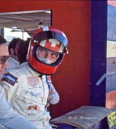 https://flic.kr/p/fbaYRN | Live fast, die young. | Racing legend Jo Siffert with his trademark helmet at Sebring in 1971. He and driver Pedro Rodriguez (far left) drove Gulf Porsche 917s at Sebring for John Wyer. Siffert would die seven months after this photo was taken at Brands Hatch. Rodriguez would die less than four months after this photo was taken driving a Ferrari 512M at Norisring in Nuremberg, Germany. The '70s were a dangerous time for many drivers.