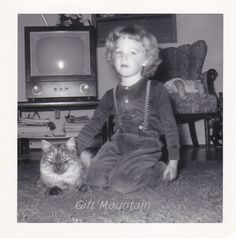 1950s Snapshot Photo Of Little Girl And Cat In by GiftMountain