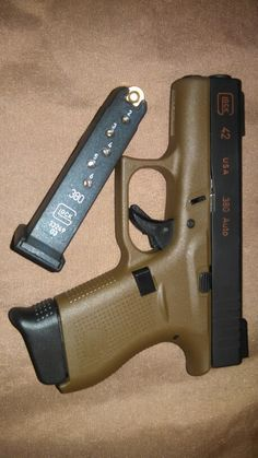 Glock 42 Flat Dark Earth - that's my girl... Find our speedloader now!  http://www.amazon.com/shops/raeind