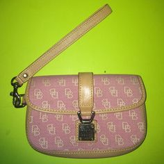 Pink Dooney and Bourke Clutch Pink and tan clutch with gold clasps. Dooney & Bourke Bags Clutches & Wristlets