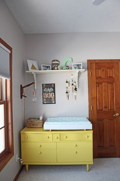 Yellow painted vintage dresser - perfect for a changing table!