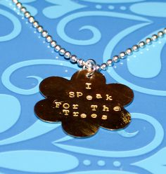 'I Speak for the Trees' metal flower stamped pendant