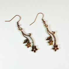 You'll shine in rich hues of antique gold and copper wearing these cheery floral Swarovski crystal drop earrings. Or get them for your favorite fan of sparking adornments. Whether for yourself or someone else, these coppery earrings are sure to make an elegant statement. They dangle 1.5 inches from the ear. The Smallest Planet Guarantee All Smallest Planet jewelry is handmade by me, Sara Kelly, in my home studio in San Diego, California. As a one-person shop, I take great pride in my w...