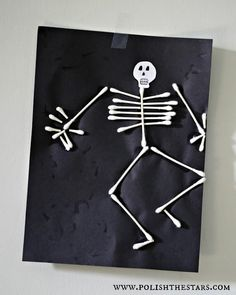 Cute skeleton made out of Q-tips. Cheap and easy to make.