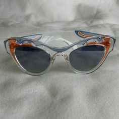 NEW Miu Miu Sunglasses Brand new Miu Miu by Miuccia Prada!   Clear frames with a blue and orange color scheme.  Signature stamp on both arms.  Pairs great with many different styles the possibilities are endless!   ??reasonable offers accepted, and bundle deals available?? Miu Miu Accessories Sunglasses