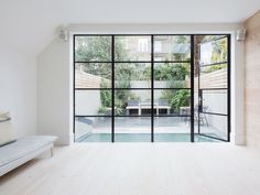 Glass door and windows. Fulham House by Daniel Lee. Photo by Rory Gardiner. Crittal Doors, Home And Living, Home And Family, Living Room, Steel Doors And Windows, Patio Doors, Home Renovation, Glass Door, New Homes
