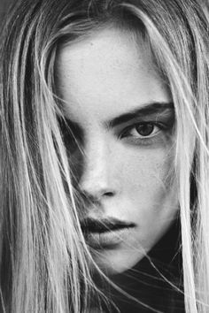 beautidl close up hair over face minimal monochrome fashion photography dark blackandwhite female portrait