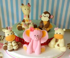 """Handmade 3D Sweet Safari/Jungle Animal Toppers Perfect for your Safari and Baby Shower Party!   consist of:  - 3 Giraffe - 2.25 Monkey  - 2.25 Zebra - 2.25 Elephant - 2.25 Hippo - name blocks up to 6 letters ** additional name block @ $2.00/pce  This item is CUSTOMIZABLE, you can change the color and pick the style of the animals! If you prefer a different color or would like to order additional quantitiy , please let me know in the """"message to seller"""" box as you checkout or convo m..."""