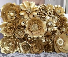 Gold paper flower wall. 3x4 ft with flowers ranging from 5-18 inches. @cindypaperie