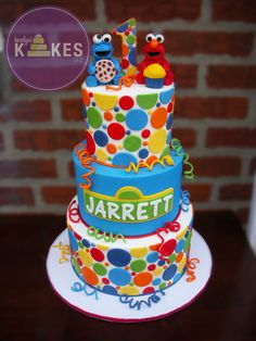 Elmo and Cookie Monster cake! Elmo and Cookie are made from marshmallow fondant and have royal icing fur. Colorful polka dots and Sesame Street sign are also MMF.