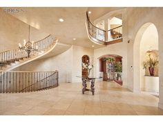 Custom finishes and a grand spiral staircase make this Niwot, CO home's foyer one of the main attractions of the house. Listed at 2,995,000.