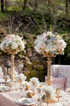 Could paint my black stands like this. Gold candelabras for height. www.botanicaevents.com