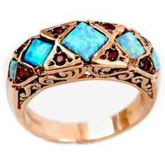 antique style 14k rose gold ring comprised of a band bearing antique etchings holding 5.5mm x 5.5mm rhombus shaped opals, divided by hourglass figures embedded with round garnets
