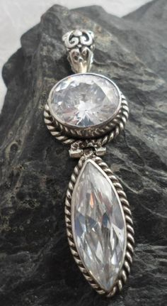 $36.00~Stunning~Sterling Silver Pendant with Two Large Faceted White Topaz Gemstones, Marquis Cut the other Oval Cut~Designed in Bali~for more details on this pendant please click on the picture.